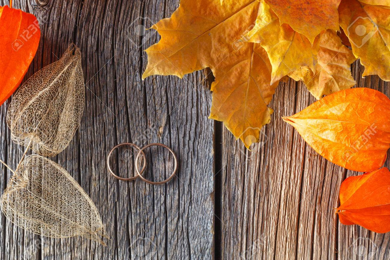 Fall Wedding Decoration Dry Cape Gooseberry And Two Rings On Rustic Background Stock Photo