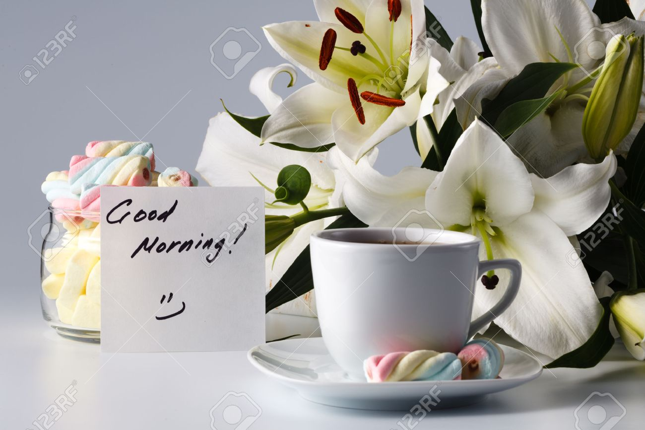 Breakfast Concept Cup Of Tea White Lily And Note Good Morning