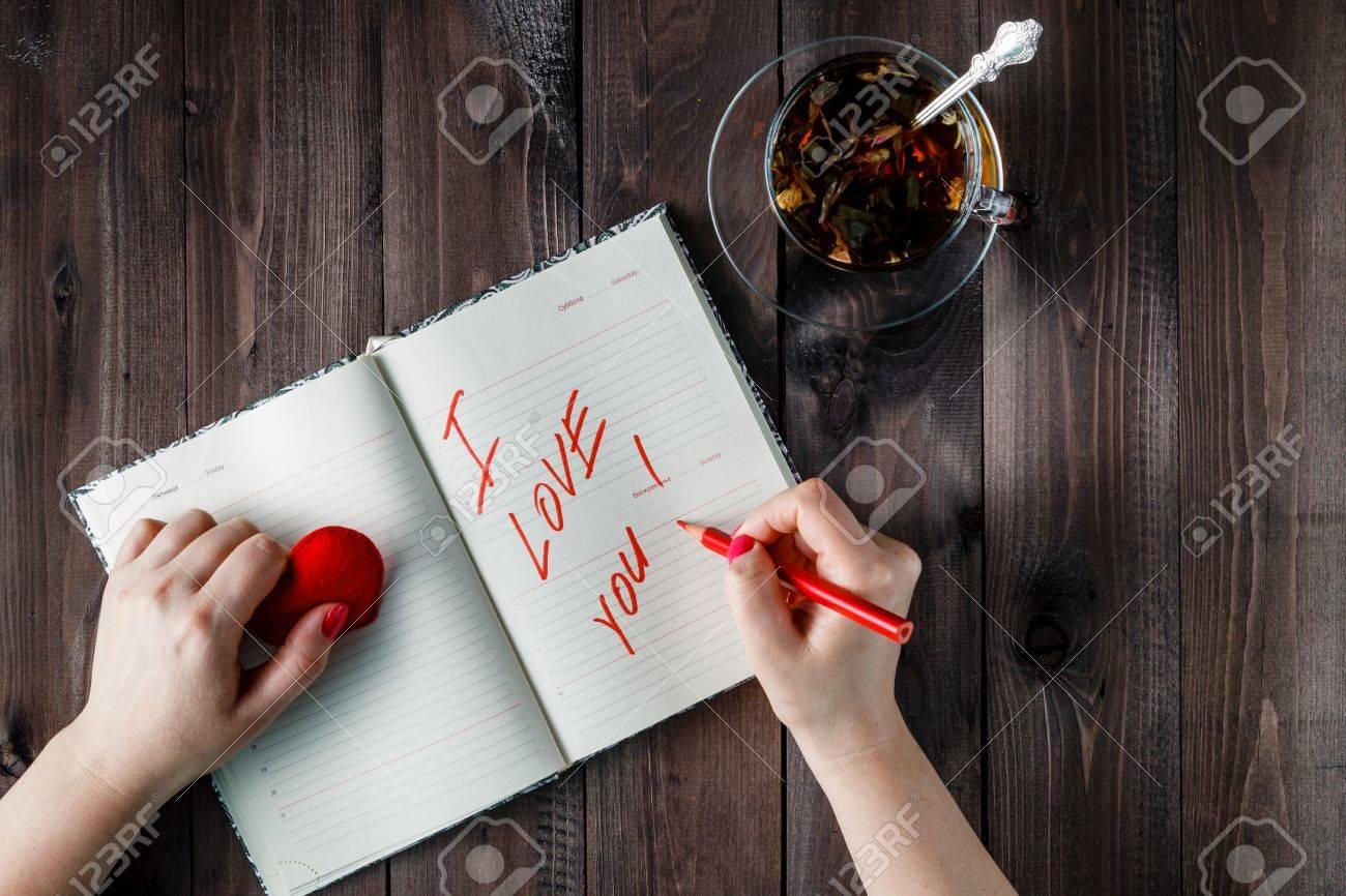 female write declaration of love in diary stock photo 50958714