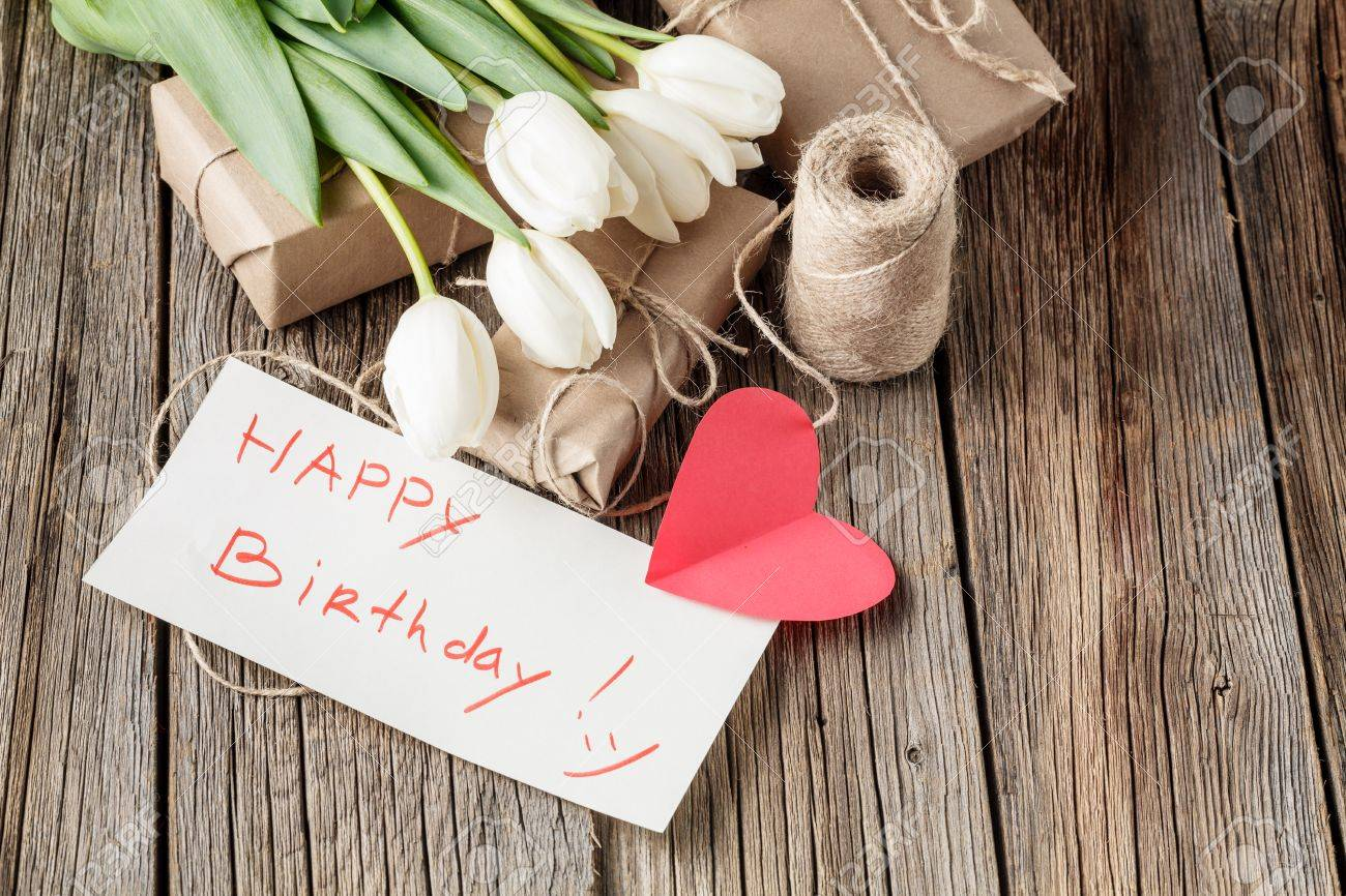 Happy Birthday Mesage With Flowers On Rustic Table Stock Photo