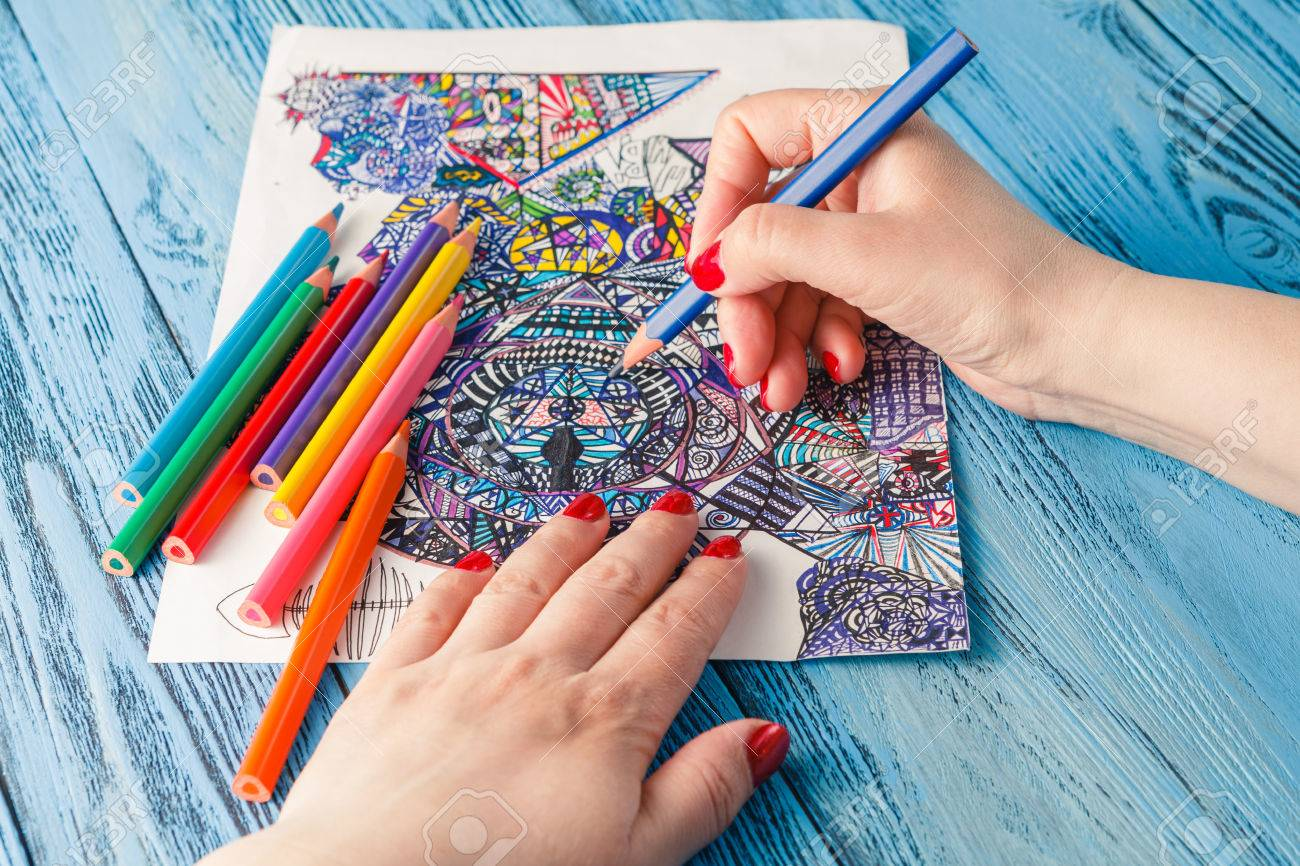 Coloring books for adults stress relief - Stock Photo Adult Coloring Books Colored Pencils Anti Stress Tendency Hobbies Woman S Hands Painting Stress Relief Painter