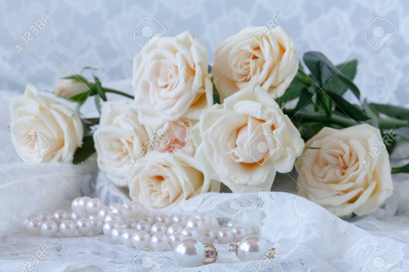White fresh flowers with pearls jewellery on white wooden table stock photo white fresh flowers with pearls jewellery on white wooden table with copy space mightylinksfo