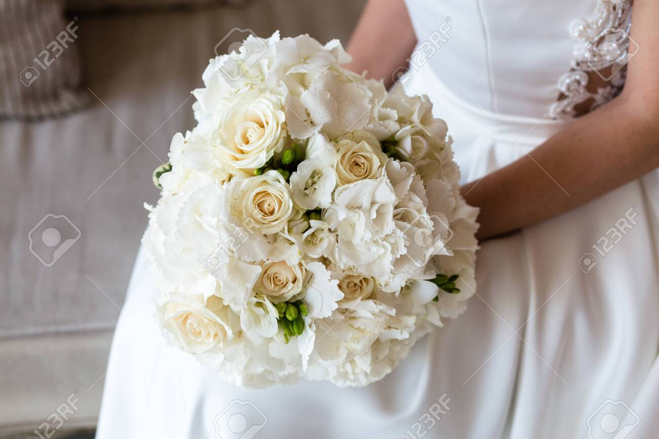 Exquisite Bridal Bouquet Of White Roses Hydrangeas And Freesia