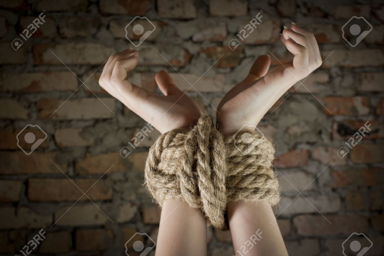 Hands tied up with rope Stock Photo - 9694509