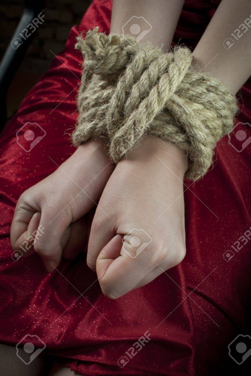 Hands tied up with rope Stock Photo - 9694512