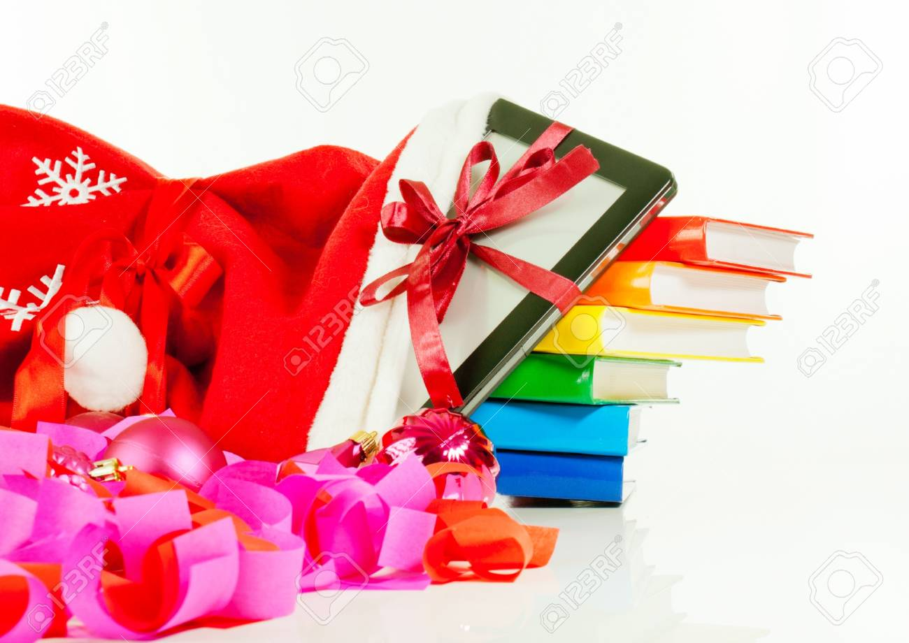 Electronic book reader with stack of books in bag against white background Stock Photo - 11593252