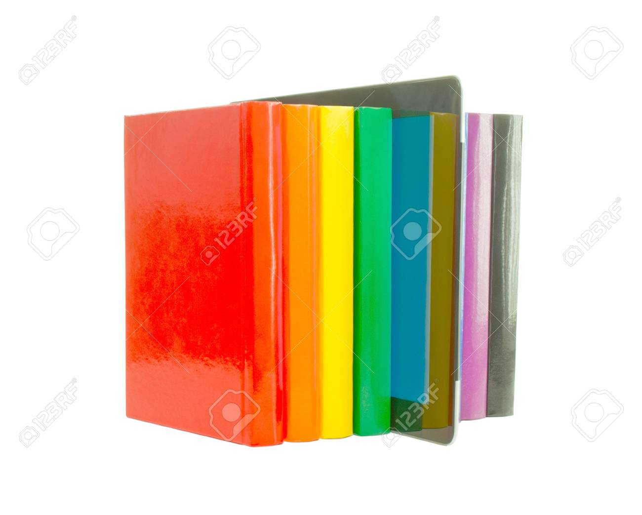 Row of colorful books and electronic book reader over white background Stock Photo - 11885503