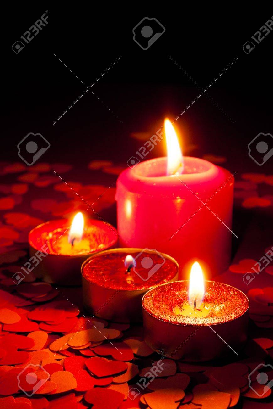 Four Burning Candles Over Red Background With Heart Shapes Fotos ...