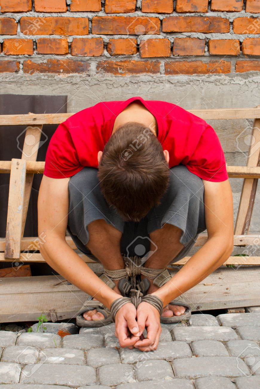 Man tied up with rope against break wall Stock Photo - 12166592