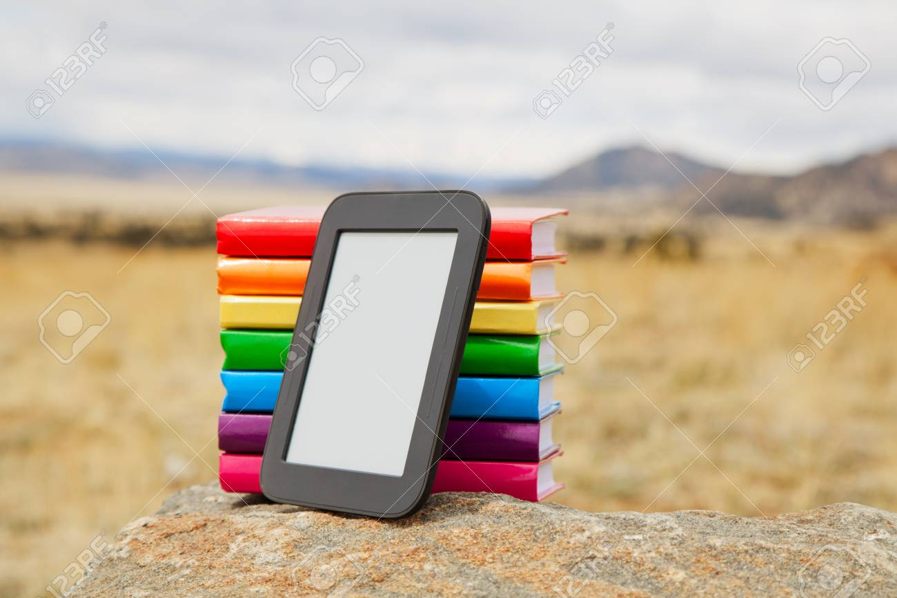 Stack of printed books with electronic book reader lying on the stone Stock Photo - 14158839