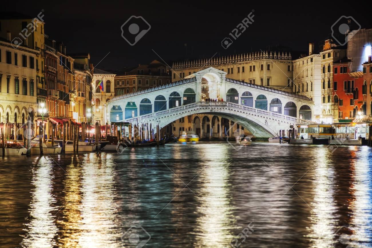 rialto bridge (ponte di rialto) in venice, italy at night time stock