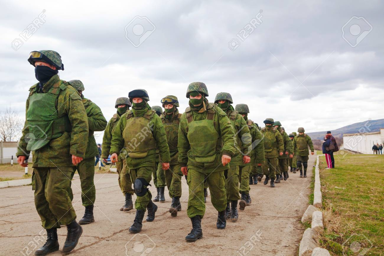 PEREVALNE, UKRAINE - MARCH 5  Russian soldiers marching on March 5, 2014 in Perevalne, Crimea, Ukraine  On February 28, 2014 Russian military forces invaded Crimea peninsula  Stock Photo - 26410707