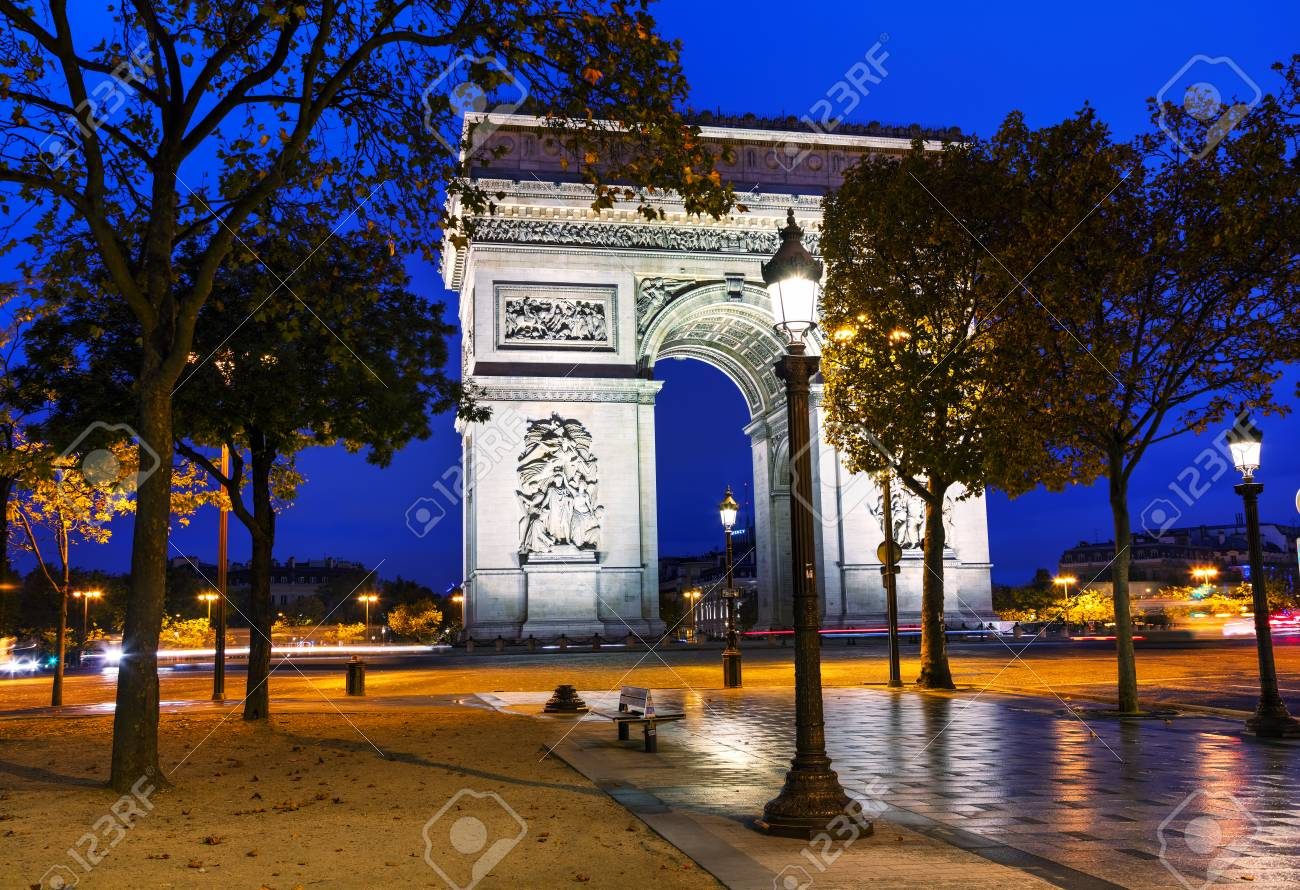 the triumphal arch arc de triomphe in paris france at night stock