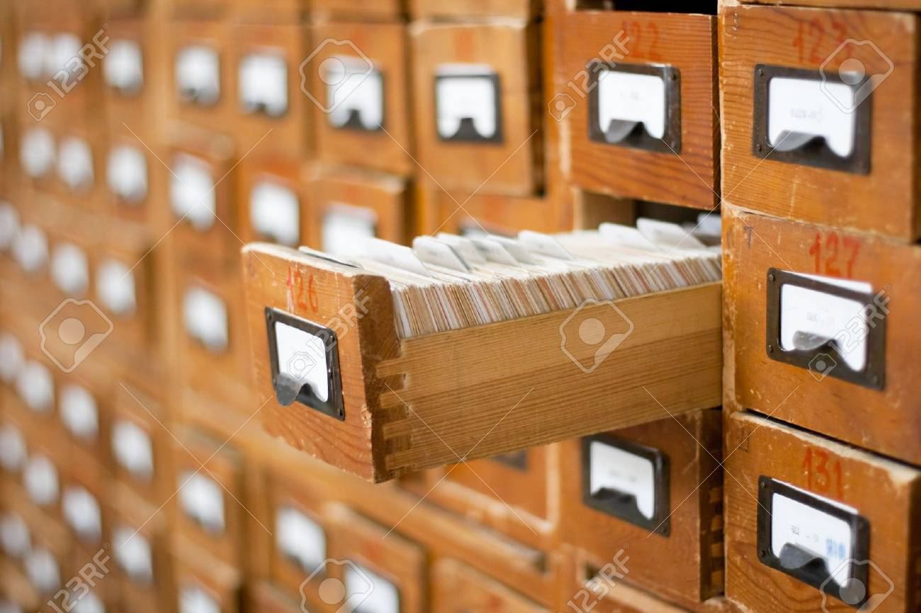 Old wooden card catalogue with one opened drawer Stock Photo - 5814472
