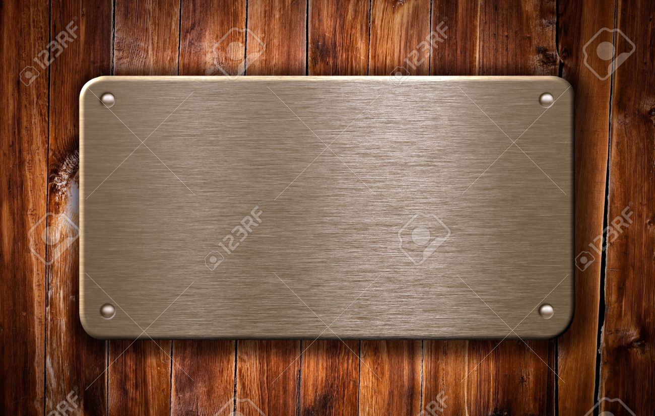 brass metal plate on wooden background Stock Photo - 7880399