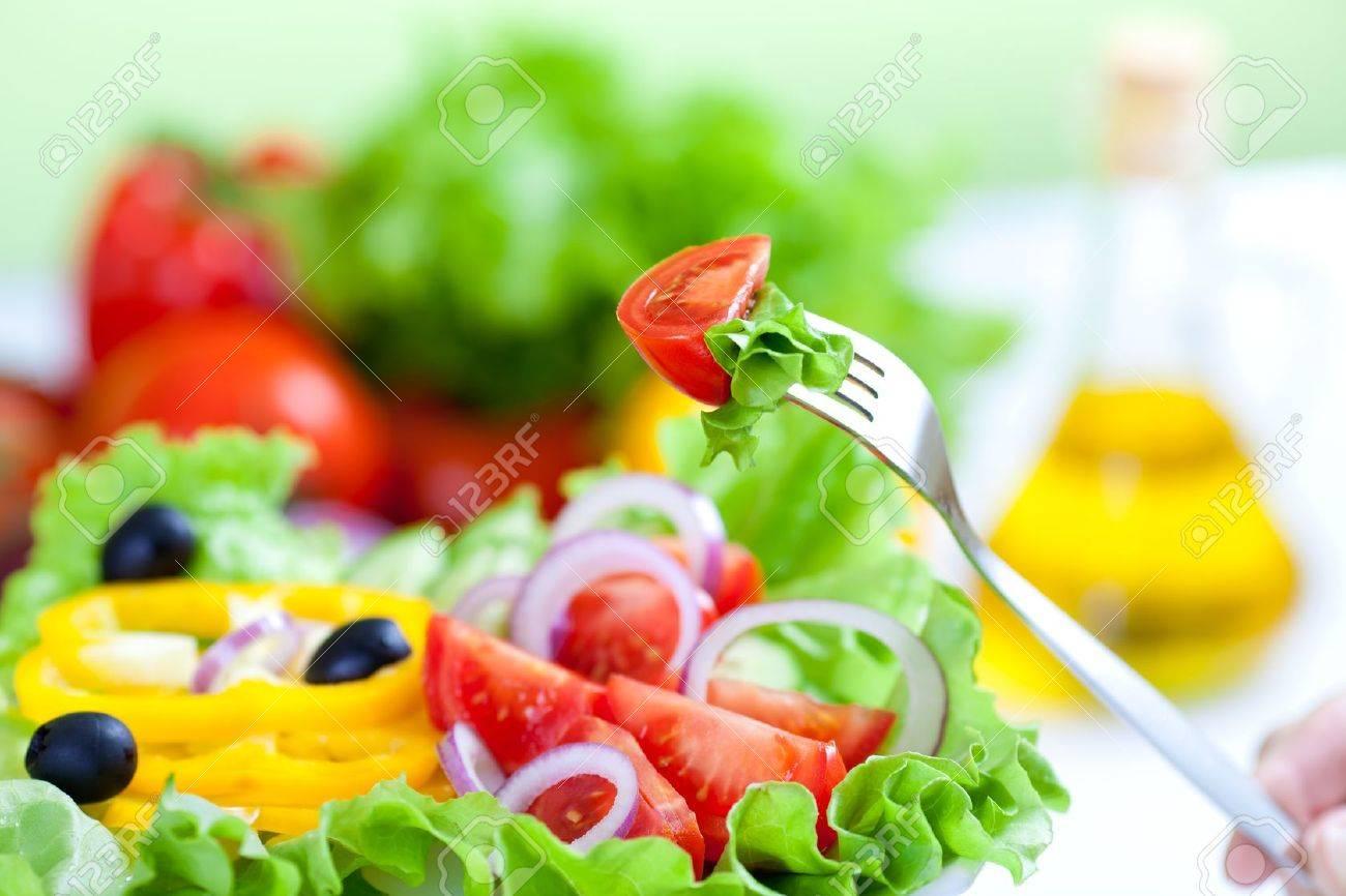 healthy fresh vegetable salad and fork - 9164190