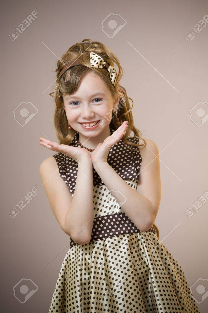 Standing elegant old-fashioned dressed little girl Stock Photo - 9636710
