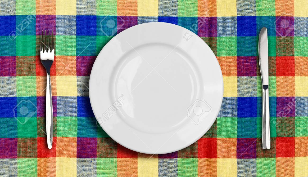 Knife, plate and fork on multicolor checked tablecloth Stock Photo - 9685683
