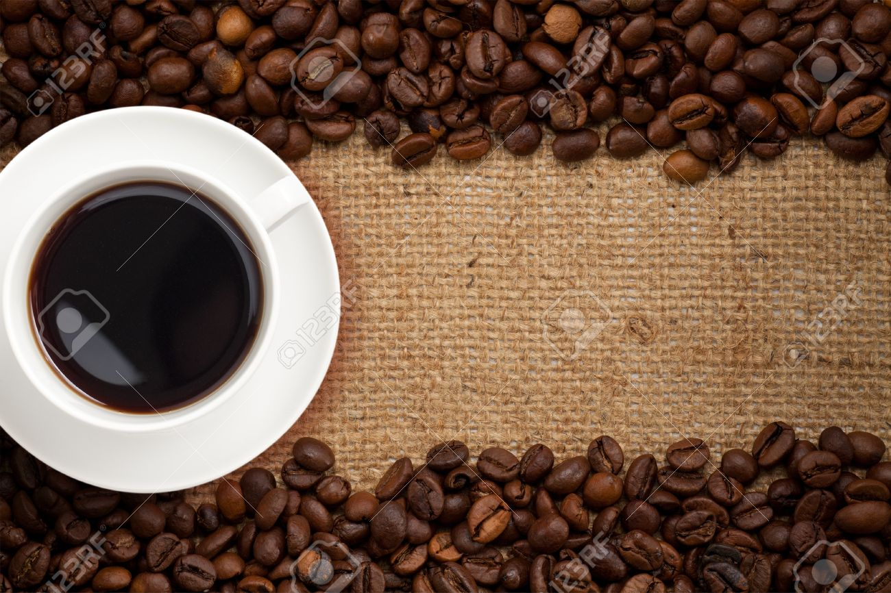 Stock Photo - coffee cup on Coffee Beans And Cup Background