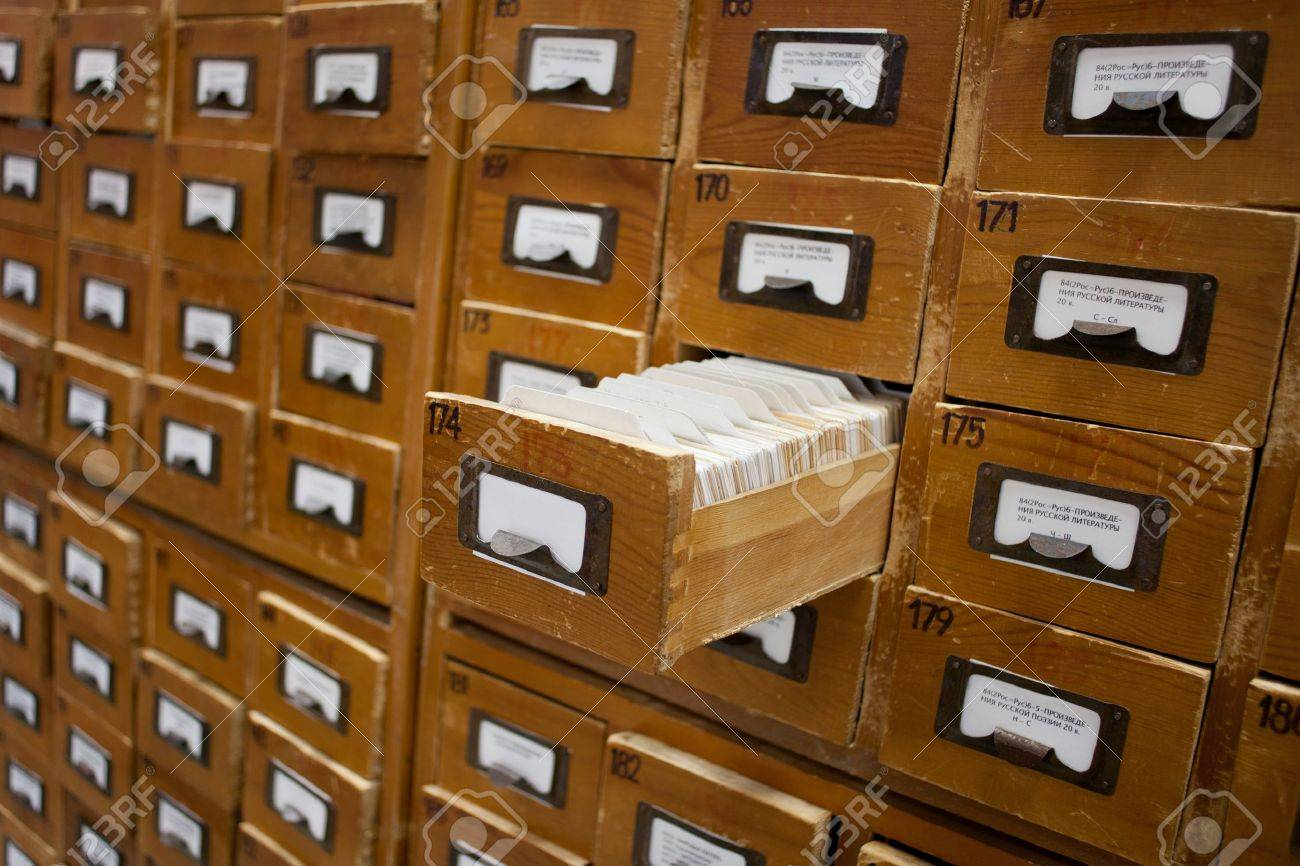 Old wooden card catalogue with one opened drawer Stock Photo - 10938126