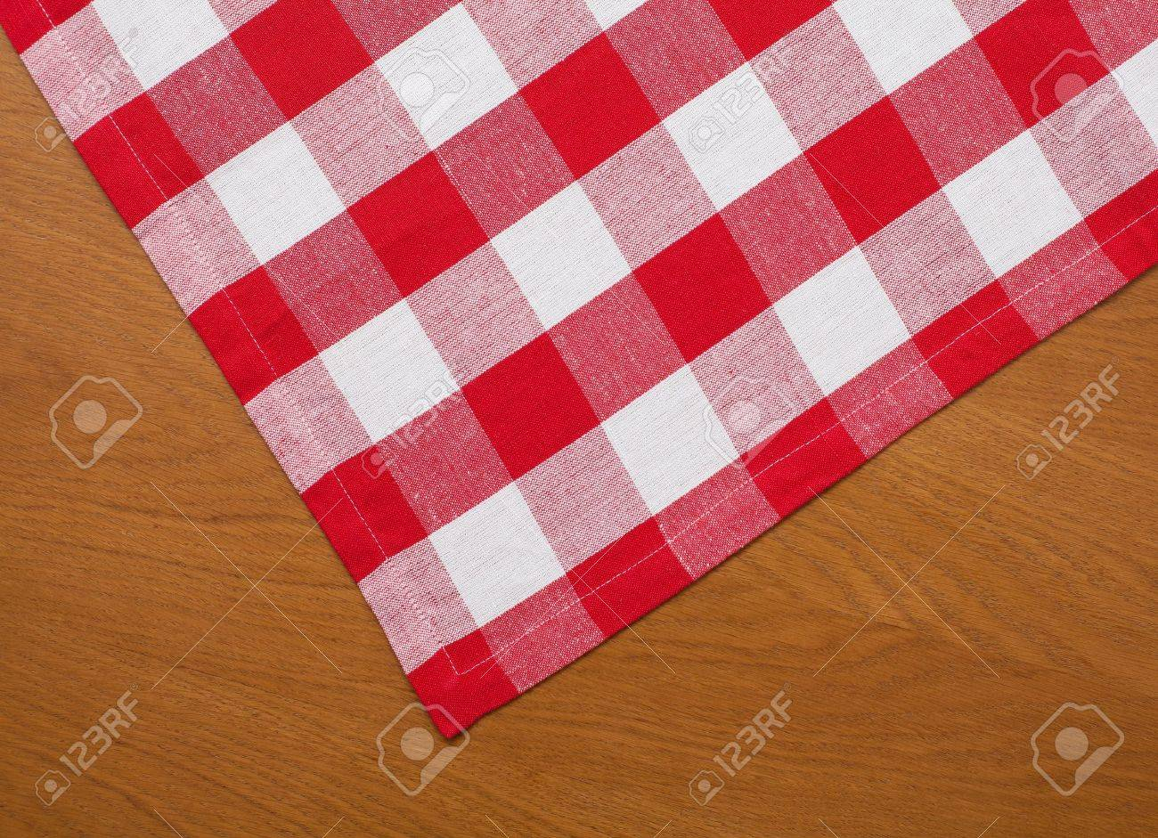 wooden kitchen table with red gingham tablecloth Stock Photo - 11918962