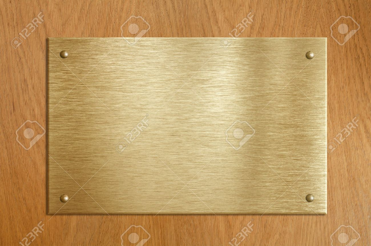 wooden plaque with gold or brass plate stock photo picture and