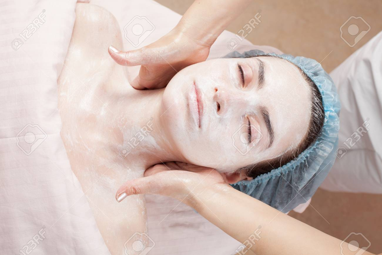 Beautiful woman with clear skin getting beauty treatment of her face at salon   Clear Skin Stock Photo - 12783847