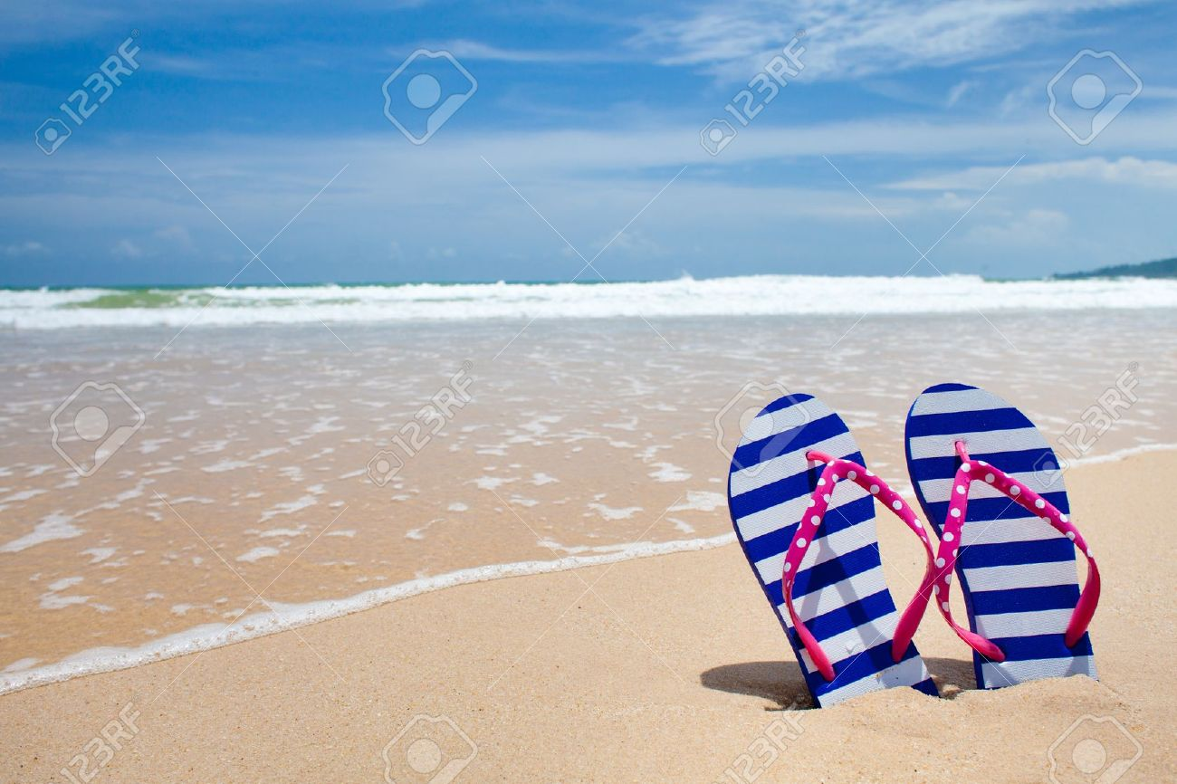 Colorful flipflop pair on sea beach Stock Photo - 14409338