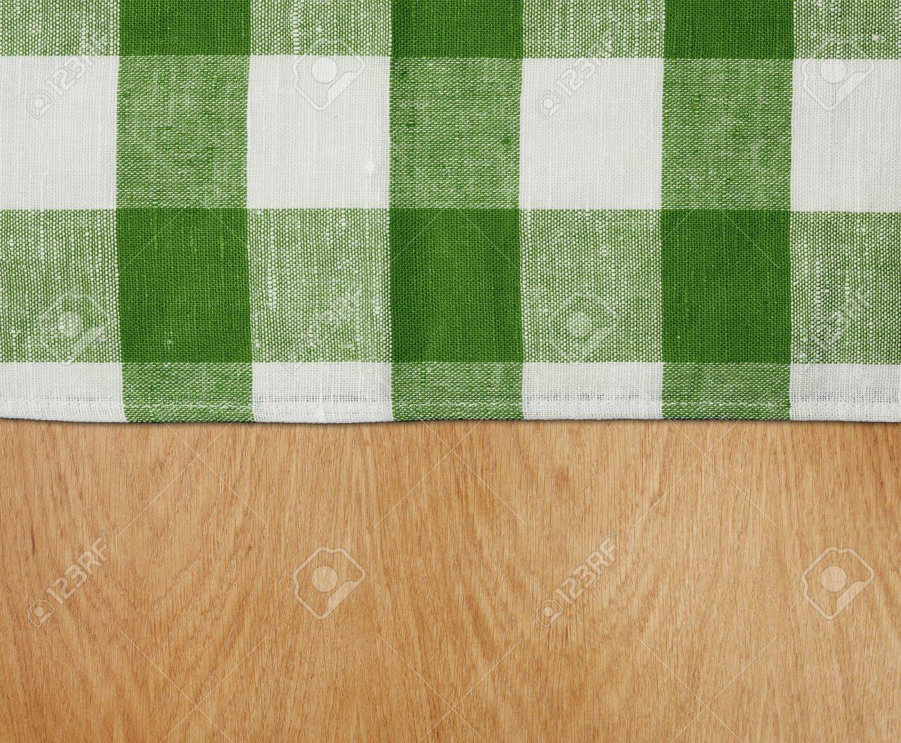 photo wooden kitchen table with green gingham tablecloth wooden kitchen table Stock Photo wooden kitchen table with green gingham tablecloth