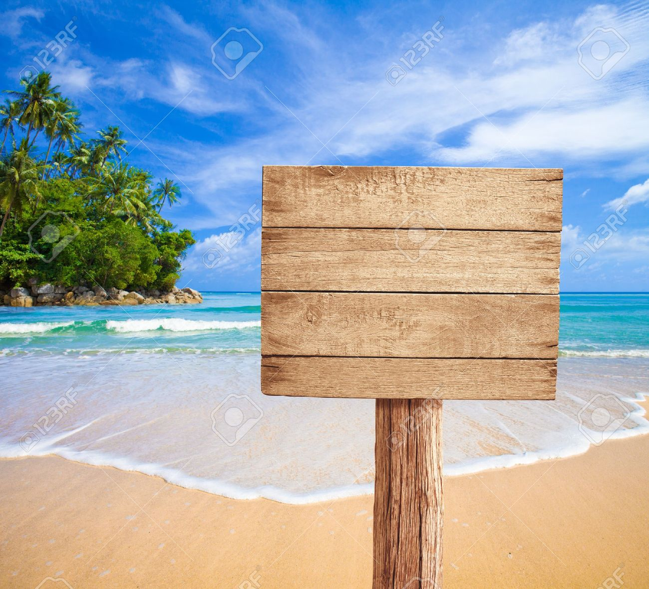 wooden signboard on tropical beach Stock Photo - 15028105