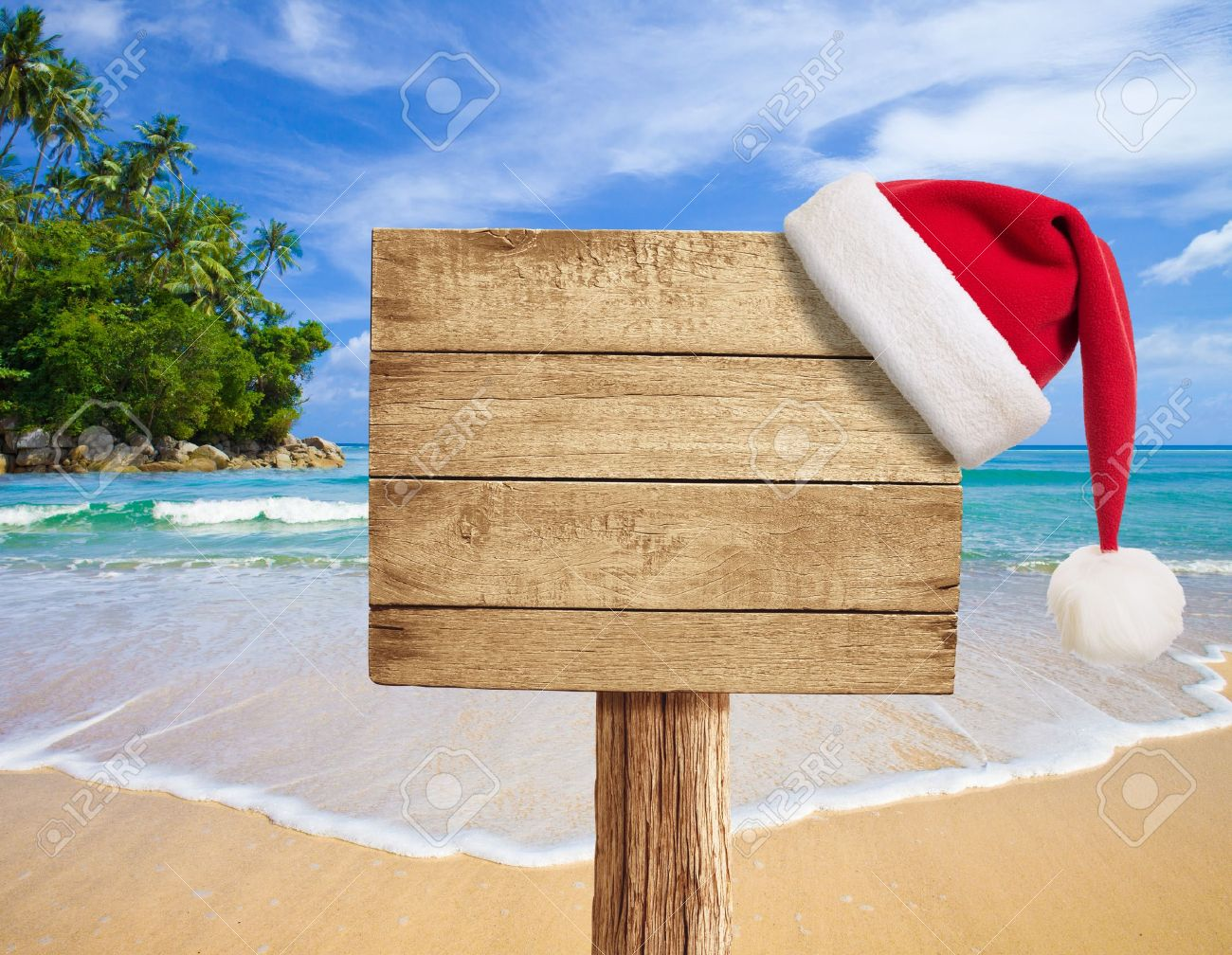 tropical beach wooden signboard with Christmas hat Stock Photo - 15437802