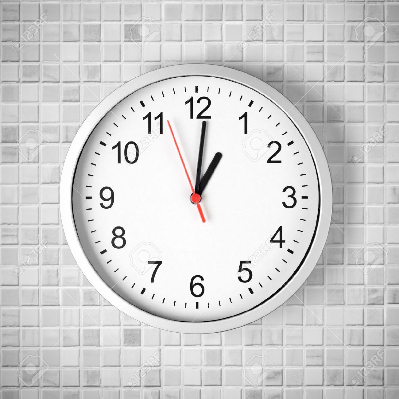 wall clock images  stock pictures royalty free wall clock photos  - wall clock simple clock or watch on white tile wall displaying one oclock