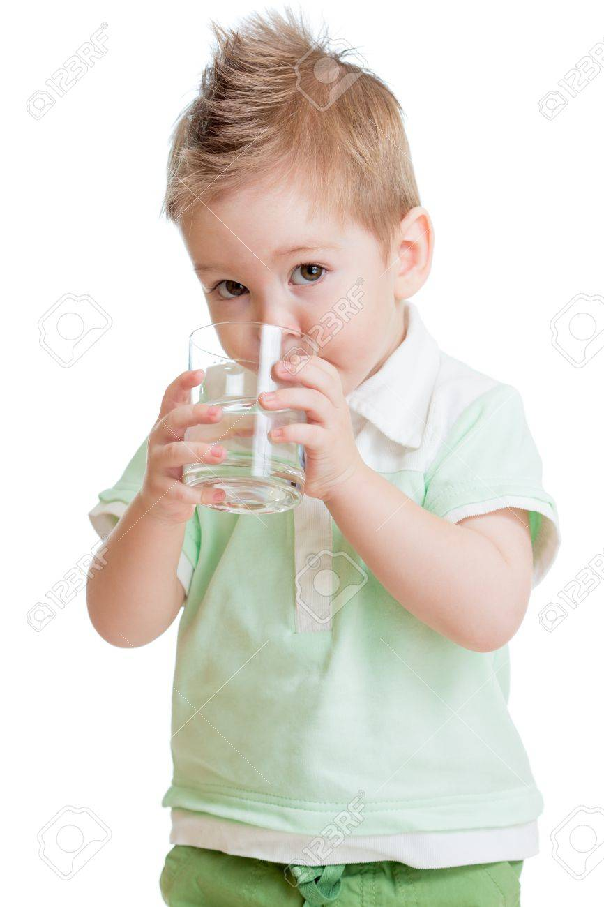 Little kid or child drinking water from glass isolated on white. It is a boy. Studio shot. Stock Photo - 16300907