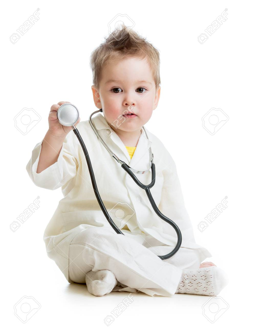 kid or child playing doctor with stethoscope isolated Stock Photo - 16300904