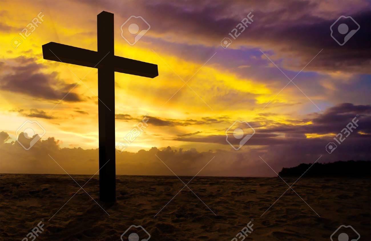 christian cross on sunset background Stock Photo - 17560104