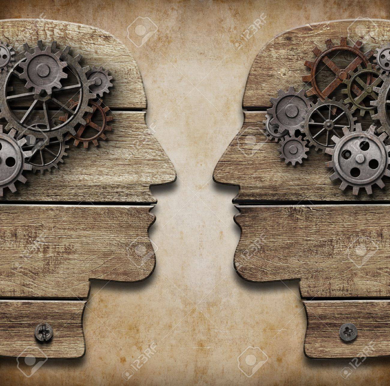 Two human head silhouettes with cogs and gears Stock Photo - 19220853