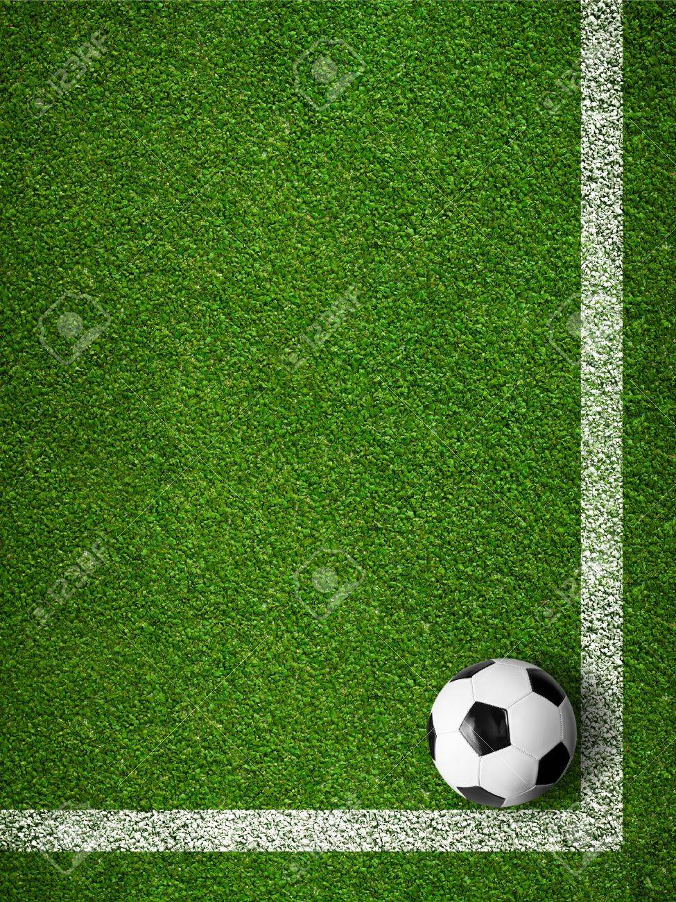 Soccer ball framed by white marking lines top view. Sport background. Stock Photo - 19377651
