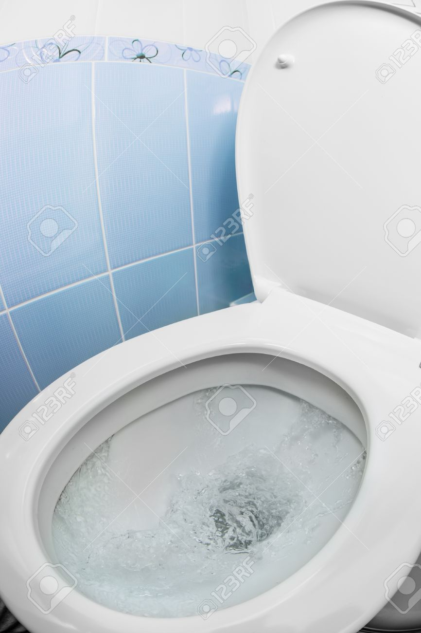 Water Flushing In Toilet Bowl Or Sink Or WC Stock Photo, Picture And ...
