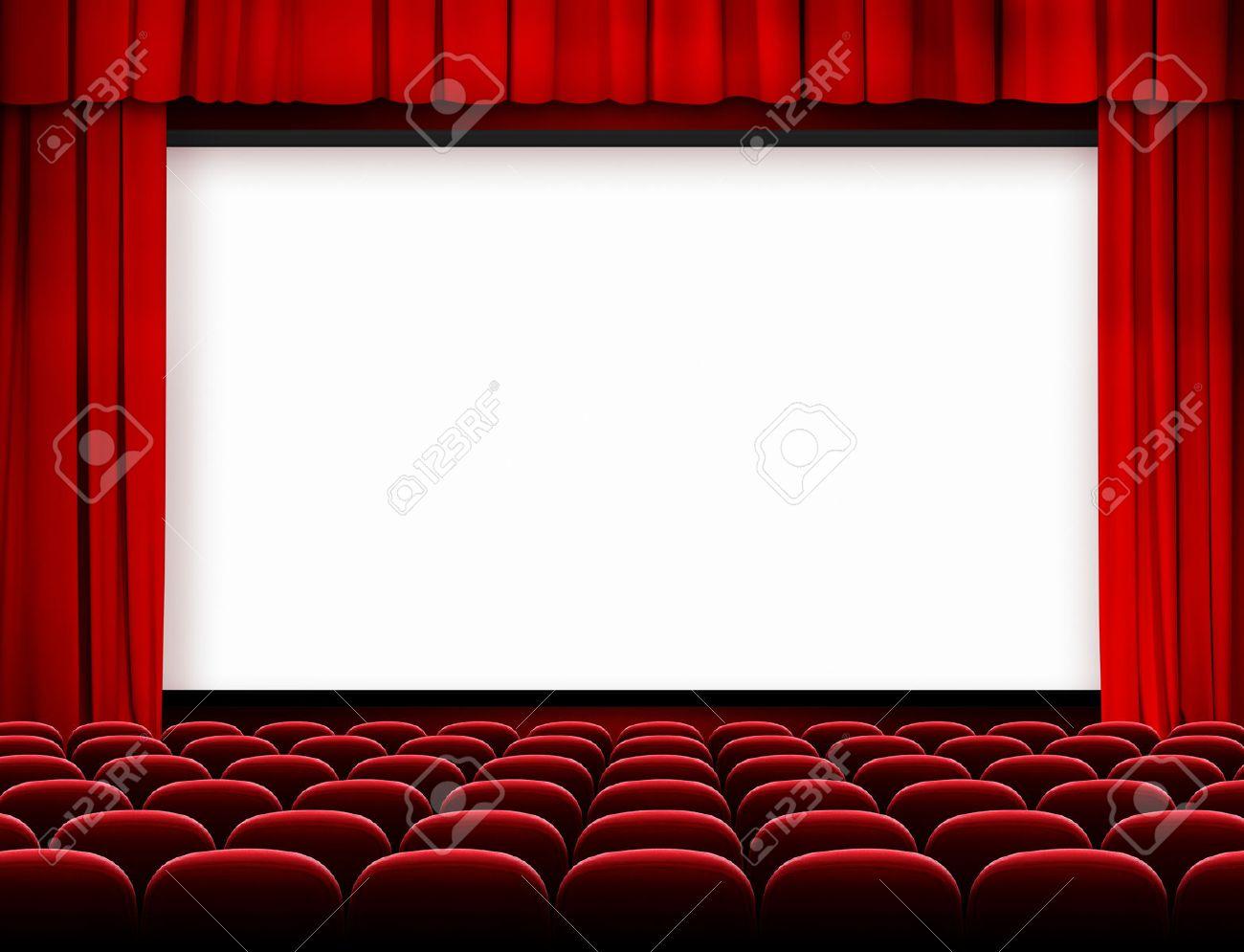 pantalla de cine con cortinas rojas y asientos foto de archivo