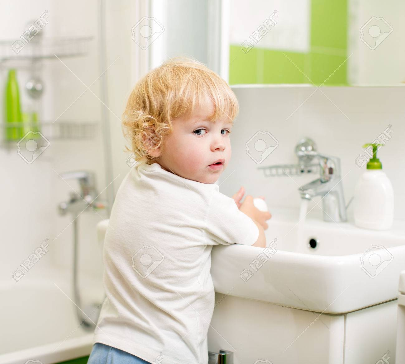 kid washing hands with soap in bathroom Stock Photo - 22806699
