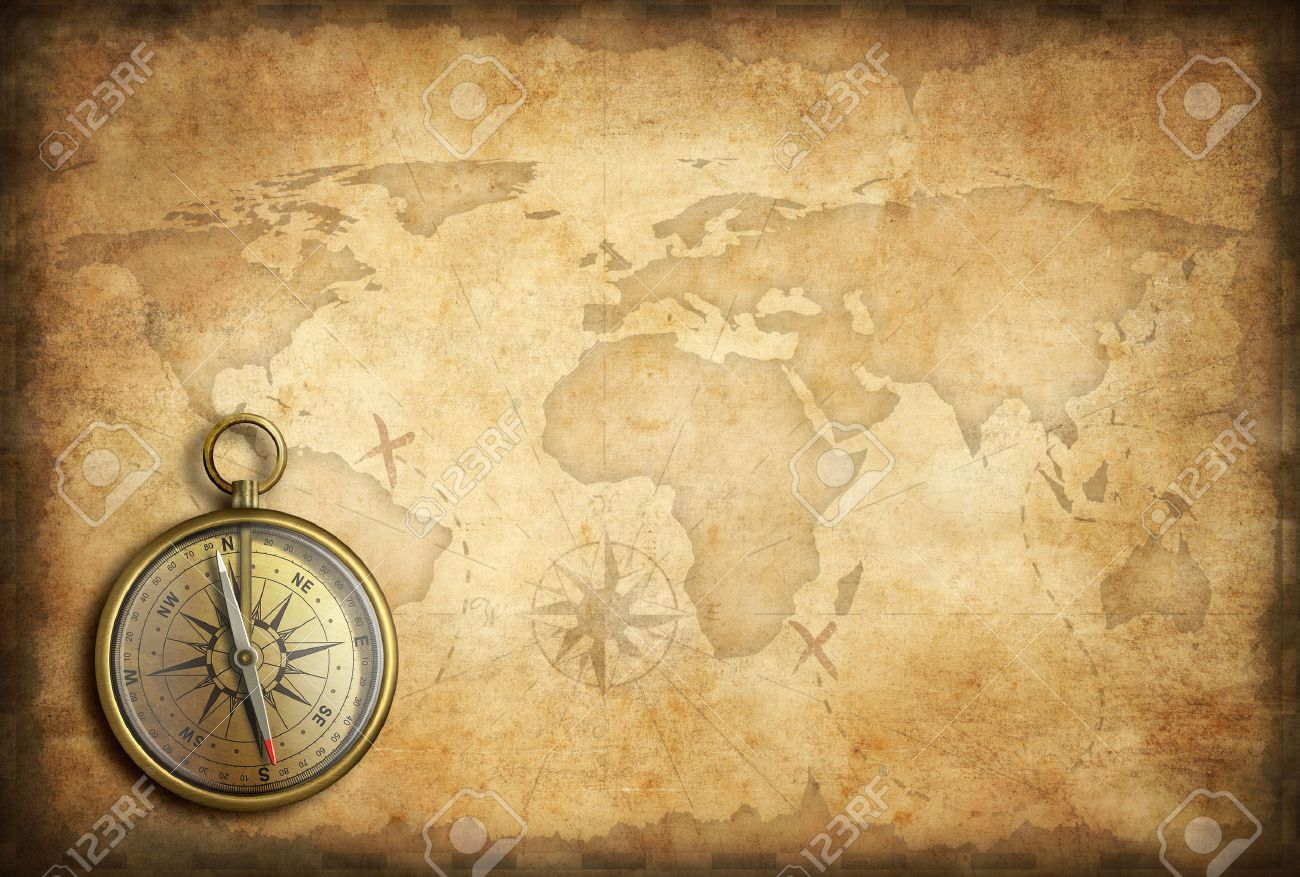 Old Brass Or Golden Compass With World Map Background Stock Photo