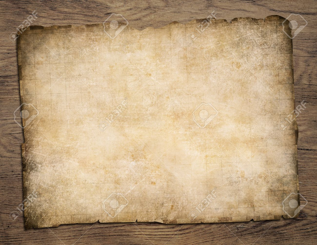 Old Blank Parchment Treasure Map On Wooden Table Stock Photo