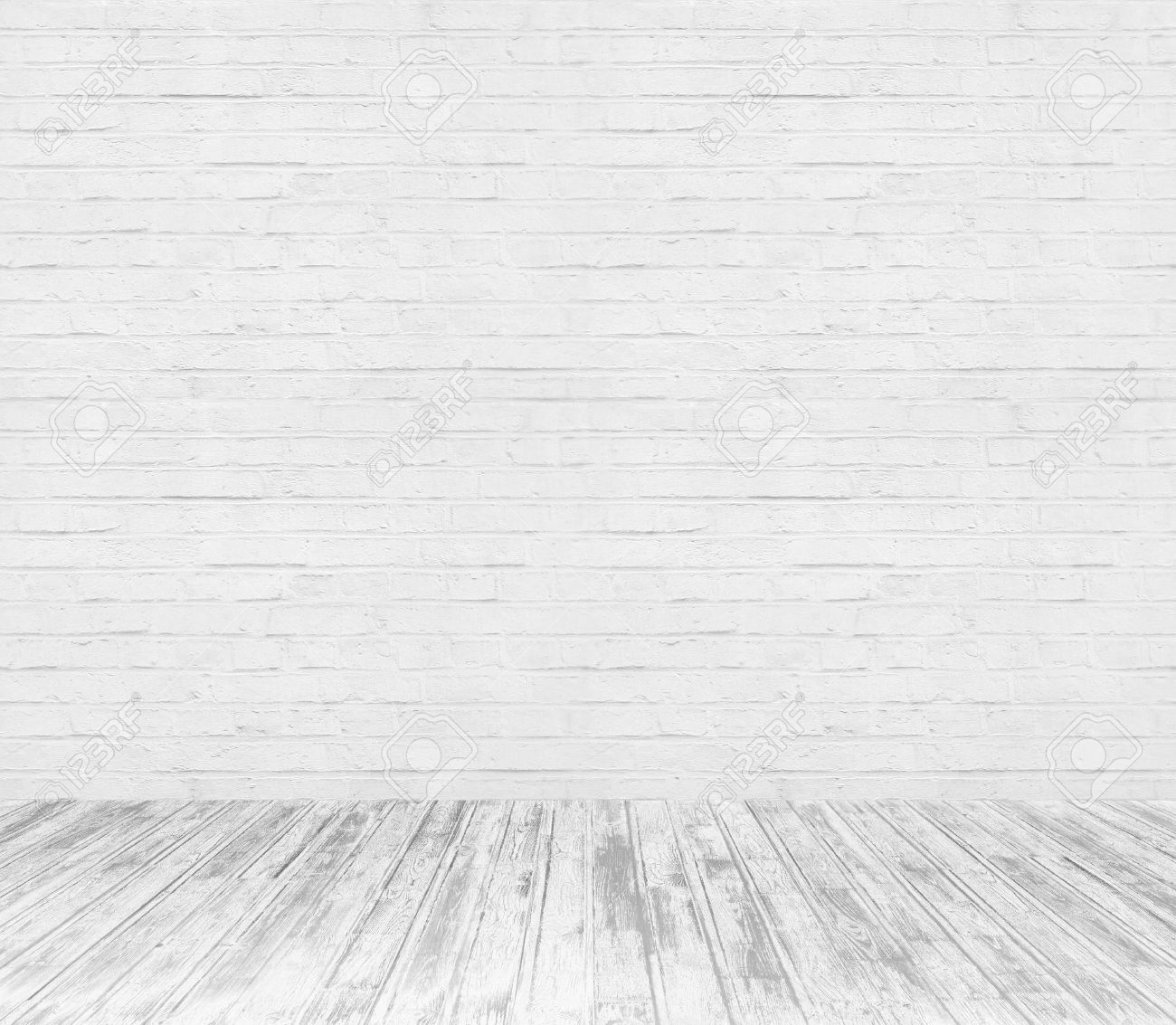 white room interior with brick wall and wood floor background stock photo 47939947