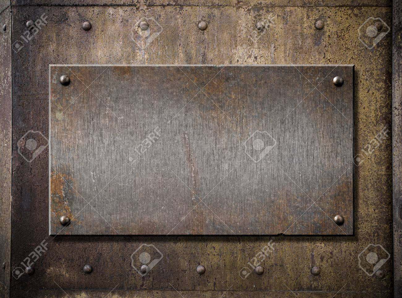 old metal plate over grunge rusty background - 56495715