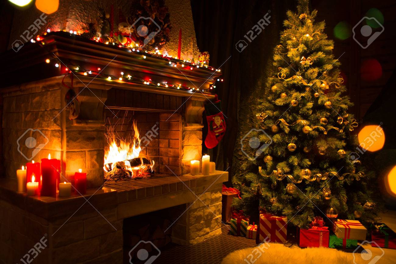 christmas tree with gifts near fireplace - 64180067