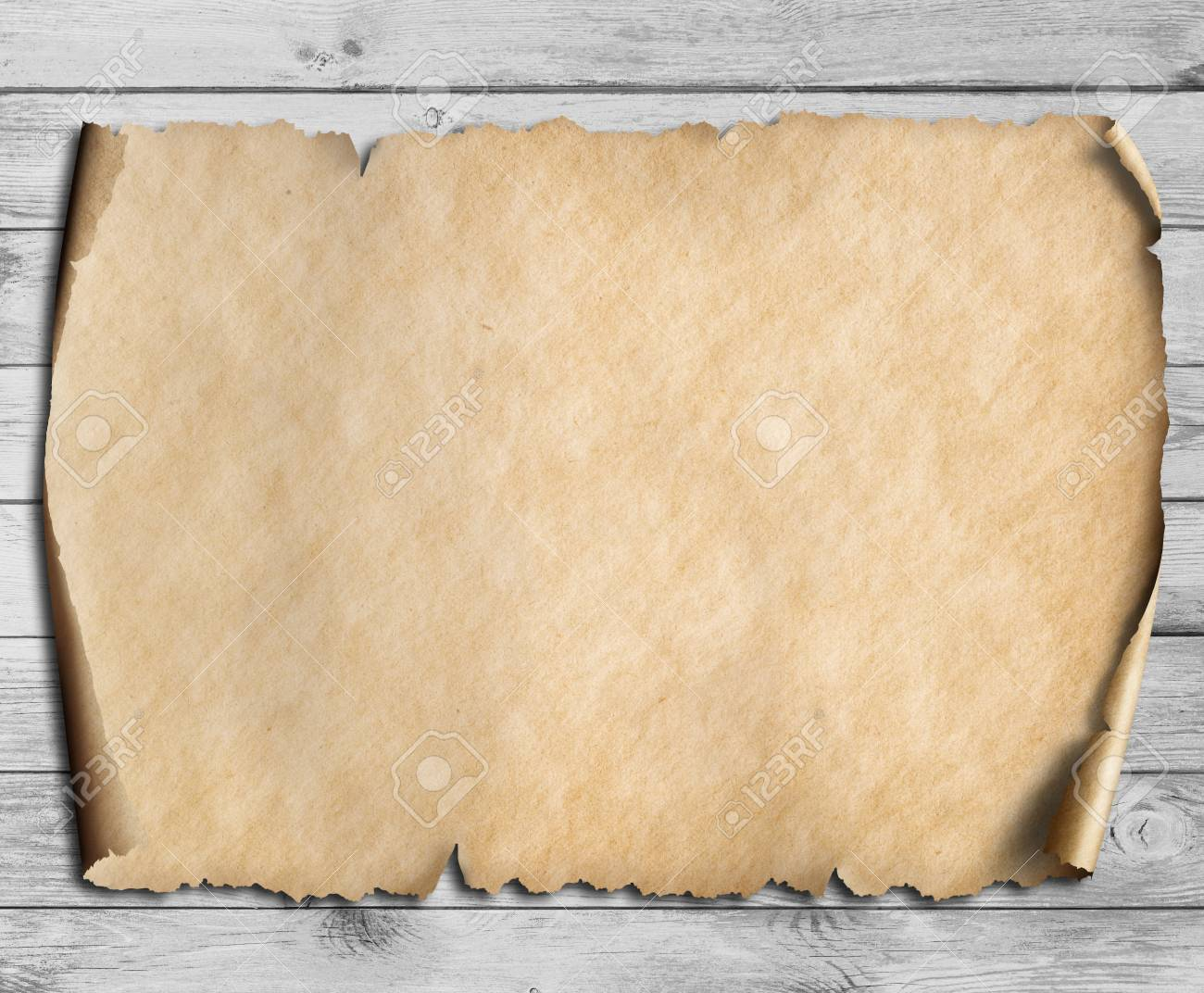 vintage scroll or map on wooden table - 75758046