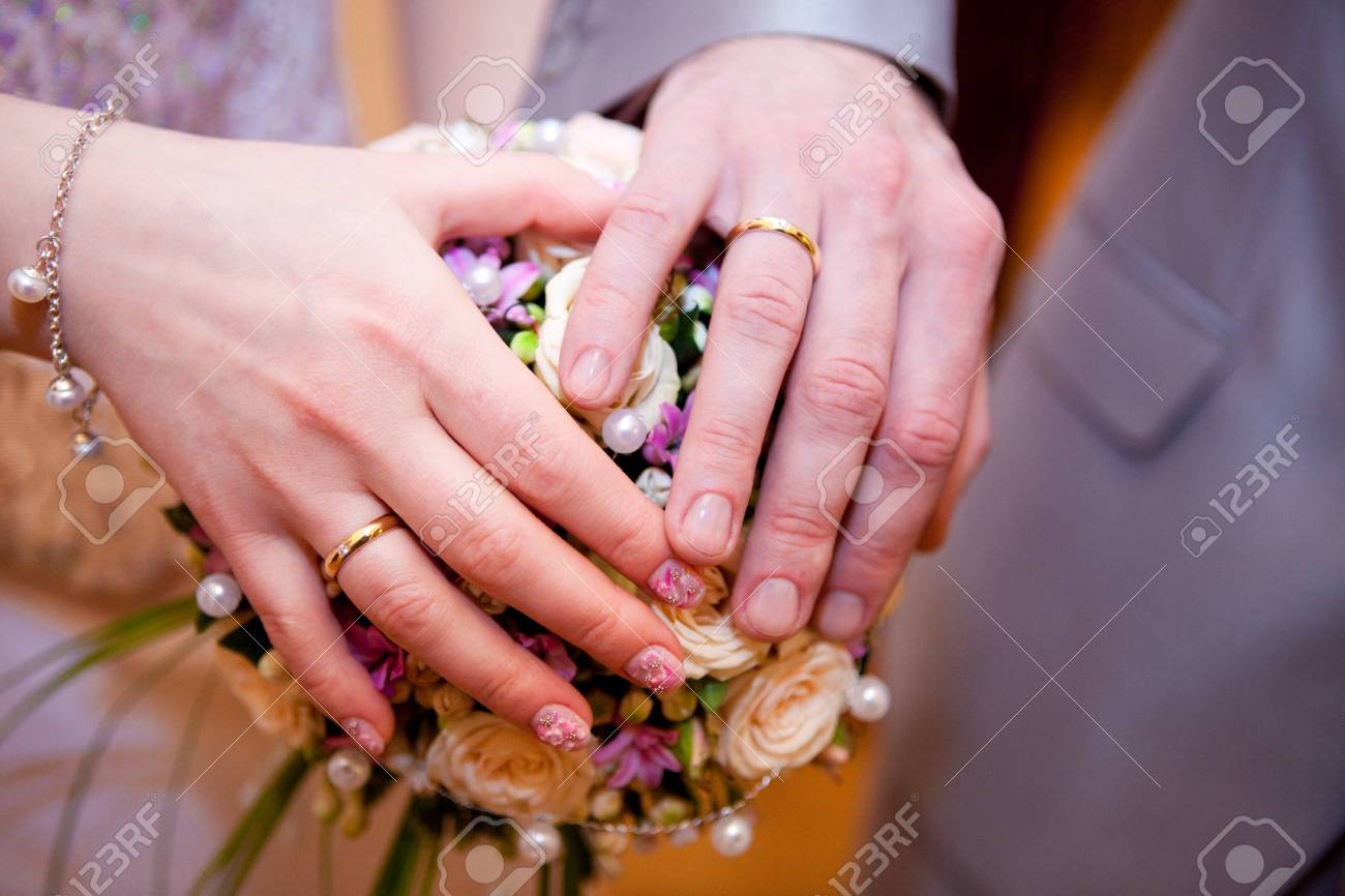 The Palms Of The Bride And Groom. Wedding Rings. The Bride\'s.. Stock ...
