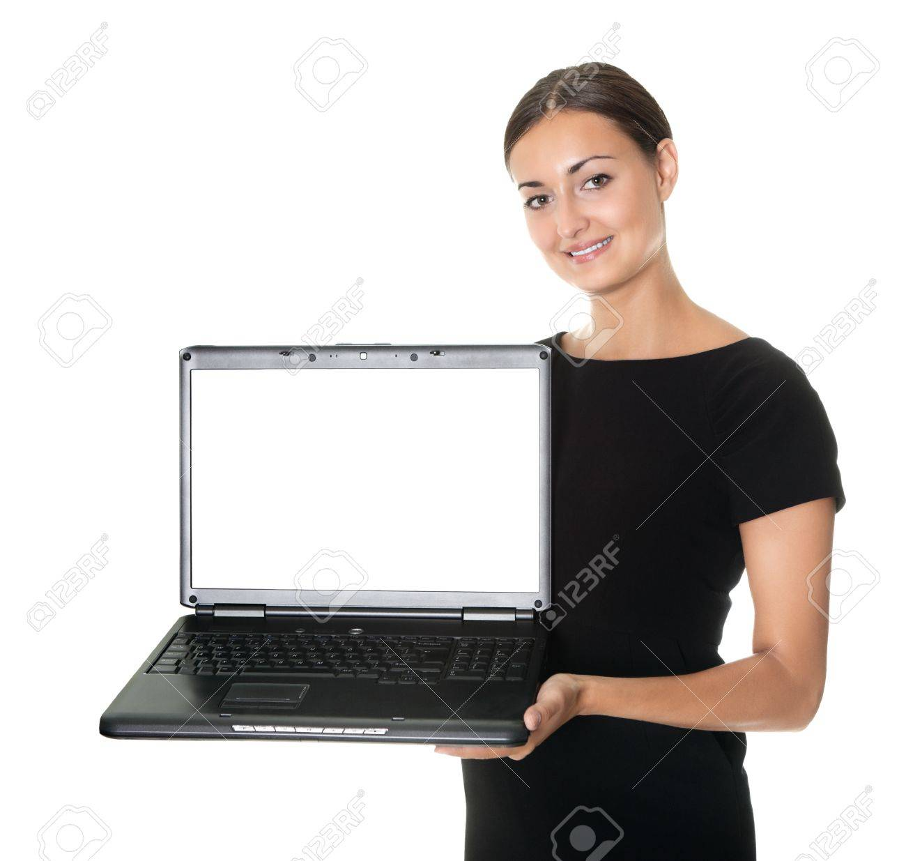 Pretty lady presenting a new laptop on white Stock Photo - 10694829