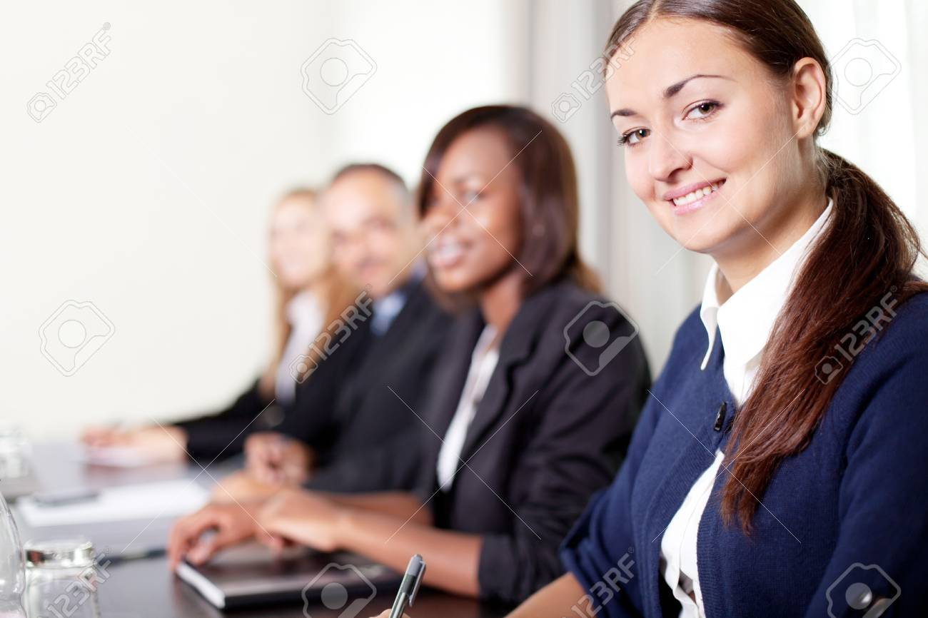Closeup of a pretty young businesswoman- smiling at the camera Stock Photo - 11080337