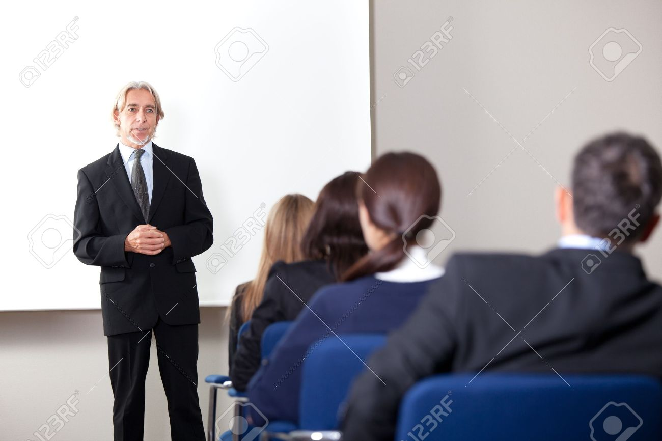 Portrait of a mature business man giving business training at a modern office Stock Photo - 11079981